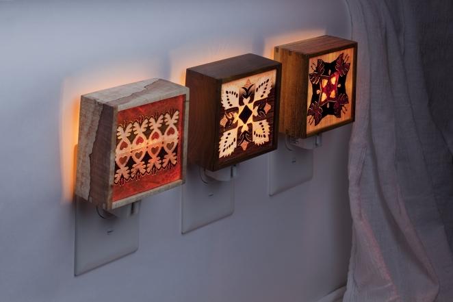 Marquetry nightlights displayed lit.